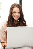 Happy woman with laptop computer Royalty Free Stock Photo