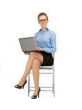 Happy woman with laptop computer. Picture of woman with laptop computer in specs Royalty Free Stock Photo
