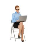 Happy woman with laptop computer. Picture of woman with laptop computer in specs Royalty Free Stock Photography