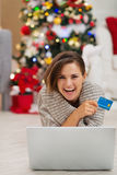 Happy woman with laptop and credit card Stock Images