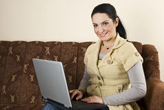 Happy woman with laptop home Stock Photography