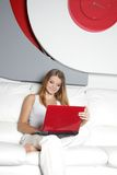 Happy woman with laptop at home. Young happy woman with laptop at home stock images