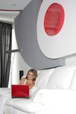 Happy woman with laptop at home. Young happy woman with laptop at home stock photography