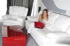 Happy woman with laptop at home. Young happy woman with laptop at home stock photos