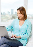 Happy woman with laptop at home Royalty Free Stock Images