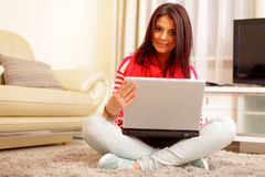 Happy woman with laptop Royalty Free Stock Images