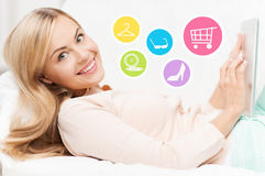 Happy woman with laptop shopping online at home Stock Photography