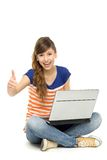 Happy woman with laptop showing thumbs up Royalty Free Stock Photos