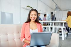Happy woman with laptop working at office stock images