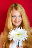 Happy woman with large flower Royalty Free Stock Images