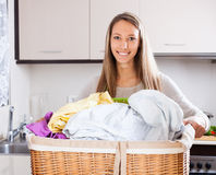 Happy woman with large linen basket Stock Image