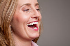 Happy woman laughing Stock Image