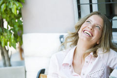 Happy woman laughing. Happy adult woman laughing outdoors Stock Photography