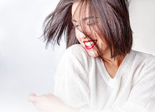 Happy woman laughing against white background. Beautiful laughing girl on a white background Stock Images