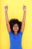 Happy woman laughing with arms raised pointing up. Portrait of happy woman laughing with arms raised pointing up Royalty Free Stock Photography