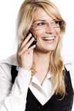 Happy woman laughing as she chats on her mobile Royalty Free Stock Images