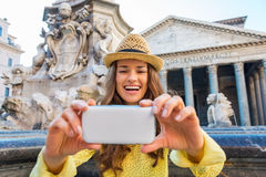 Happy woman laughing as she is checking her photo at Pantheon Royalty Free Stock Images