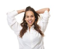 Happy woman laughing with hands in hair Royalty Free Stock Photos