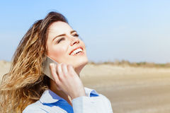 Happy woman laughing on the mobile phone Stock Images