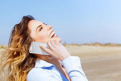 Happy woman laughing on the mobile phone Royalty Free Stock Photo