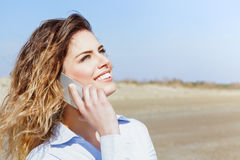 Happy woman laughing on the mobile phone Stock Photos