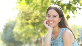 Happy woman laughing looking at camera in a park stock video footage