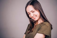 A happy woman laughs with her eyes closed. Happiness, laughter, smile, emotion concept royalty free stock photos