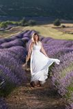 Happy Woman in Lavender Field stock photo