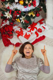 Happy woman laying near Christmas tree Royalty Free Stock Images