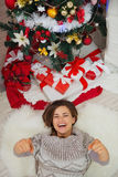 Happy woman laying near Christmas tree Stock Photo