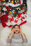 Happy woman laying near Christmas tree Royalty Free Stock Photos