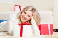 Happy Woman Laying On The Floor With Gifts Royalty Free Stock Photos