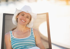 Happy woman laying on sun bed Royalty Free Stock Photography