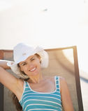 Happy woman laying on sunbed Stock Images
