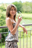 Happy woman leaning on railing with wine glass Royalty Free Stock Photos