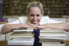 Happy Woman Leaning On Stack Of Books Stock Image