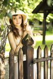 Happy woman leaning on the wooden fence Stock Image
