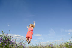 Happy woman leaping Royalty Free Stock Image