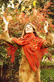 Happy Woman with Leaves in Autumn Park royalty free stock photography