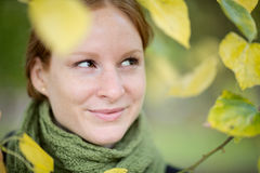 Happy Woman Among Leaves in the Fall Stock Image