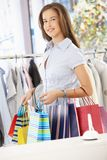 Happy woman leaving clothes shop Royalty Free Stock Images