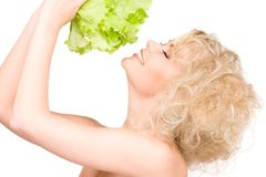 Happy woman with lettuce Royalty Free Stock Photography