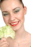 Happy woman with lettuce leaf. Stock Photo