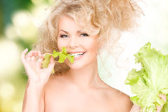 Happy woman with lettuce Stock Images