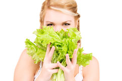 Happy woman with lettuce Stock Photography
