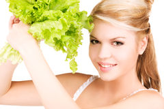 Happy woman with lettuce Royalty Free Stock Image