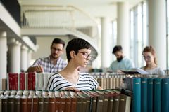 Happy woman at the library Royalty Free Stock Images