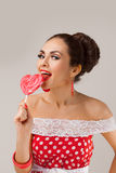Happy Woman Lick Red Lollipop. Pin-up retro style Stock Images