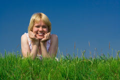 Happy woman lie on grass Stock Images