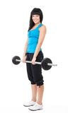 Happy woman lifting bar with weights Stock Photography